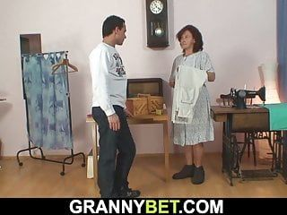 Sewing granny sucks and rides his youthful dong